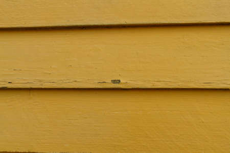 improvment: Facade exterior planks with cracks in teh panit and flakes coming loose, need of repaint.