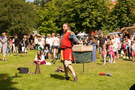 Wadkoping Orebro Sweden Juli 2016 mediaval fair with market and nights reenactment joker performing