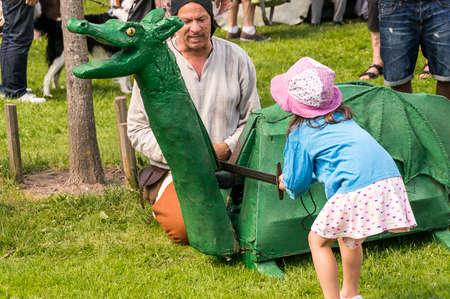 Wadkoping Orebro Sweden Juli 2016 mediaval fair with market and nights reenactment kids chopping of dragons head.