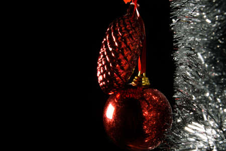 Christmas decorations red and silver hanging with silvery glitter.