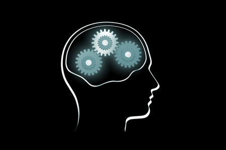 mental work: The contour of a human head on a dark background Rotate the gears  the symbol of mental work   Stock Photo