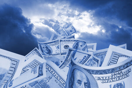 american dollar: It is a lot of dollars on a background of the sky  Stock Photo
