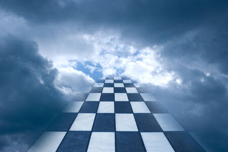 Chess board on a background of the dark blue sky
