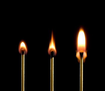 Three matches on a black background  Beautiful fire  photo