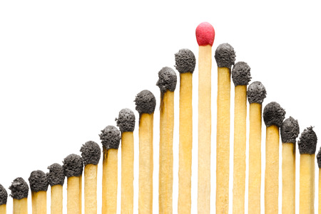 The used matches on a white isolated background  one match the whole   Imagens