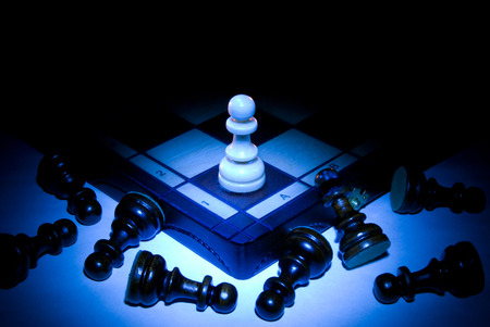 overthrow: Chess board and pawns  A dark blue art background