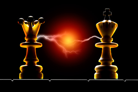 chess king: Queen and king on a black background  Art illumination  Stock Photo