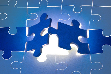 missing link: Dark blue puzzles  It is a metaphor  the beginning; opening; end   Stock Photo