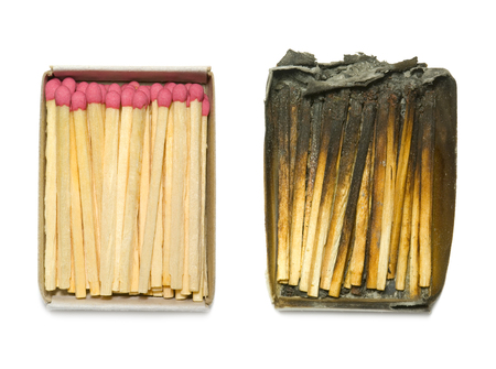 burnt wood: Matches in a paper box  burned down and the whole   An isolated white background  Stock Photo