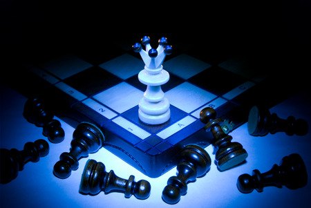 overthrow: Chess board, queen and pawns  A dark blue art background