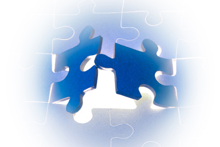 lacking: Dark blue puzzles  It is a metaphor  the beginning; opening; end   Stock Photo