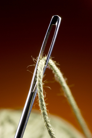 Metal needle and string  Very much a close up Art background  photo