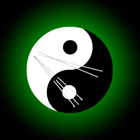 Acupuncture needles and a symbolical background  the yin-yang   photo