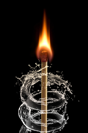 Burning match and stream of water  on a black background   photo