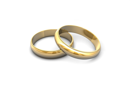 wedding vows: Gold wedding rings isolated on white background.