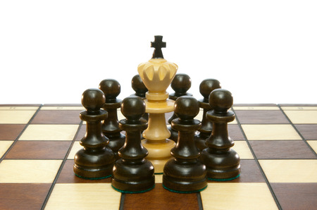 chessmen: Chessmen and chess board on a white isolated background.