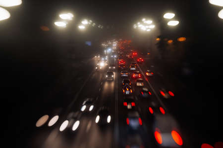 Busy traffic in city fog blur lights of cars on road Stock fotó