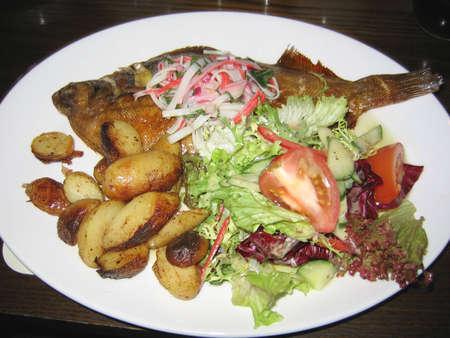 Dab Fish with Roast Potatoes and Salad photo