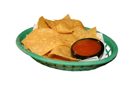 nibbles: Isolated Tortilla Chips and Spicy Tomato Dip in Green Plastic Basket Stock Photo