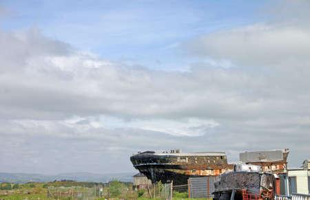 battered land: Old Ship Wrecks at Ayr Scotland UK