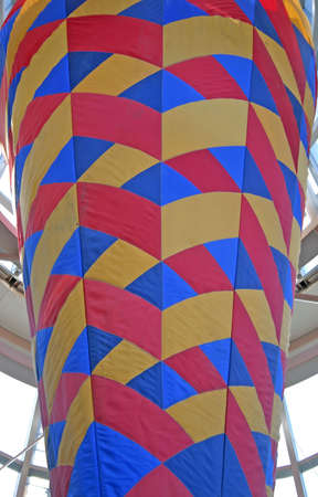 stitchwork: Closeup of Large Code Shaped Red Yellow and Blue Decoration