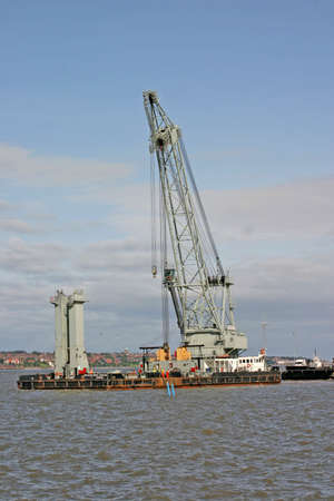 mersey: Massive Water Crane Barge on River Mersey in Liverpool England UK