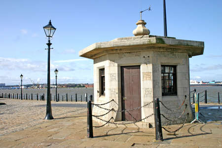 Small Stone Building Near Albert Dock Buildings in Liverpool England UK photo