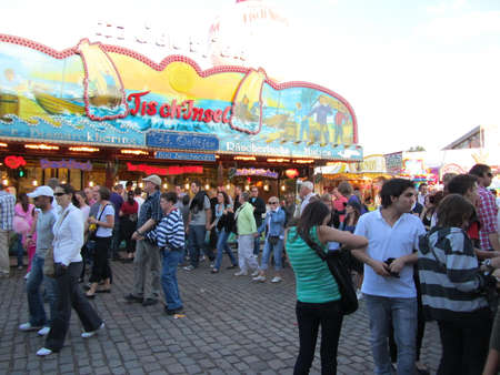 DUSSELDORF, GERMANY - JULY 24: Visitors at Fried Fish Stall at Kirmes on July 24, 2010 in Dusseldorf, Germany. Kirmes is the biggest summer fair on the north Rhein in Germany. Stock Photo - 7880949
