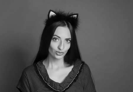 bezel: Beautiful and healthy girl model with long hair. Black and white photography. Bezel with ears