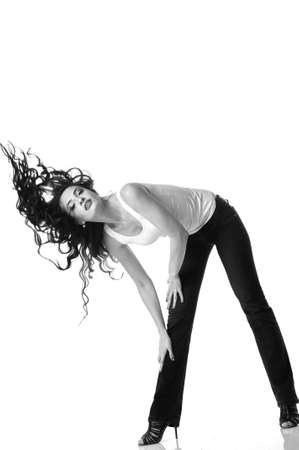 bent over: Beautiful woman with long brown hair bent over. Black and white photo