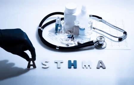 asthma: Diagnosis - Asthma. Medical concept with pills, injection, stethoscope, cardiogram and a syringe