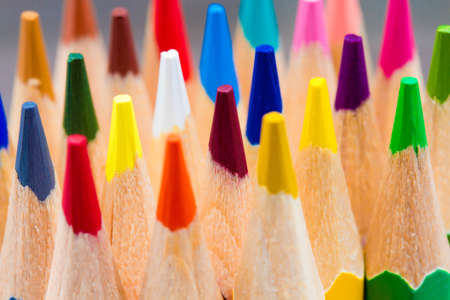 leading education: Colorful wooden pencils on grey background Stock Photo