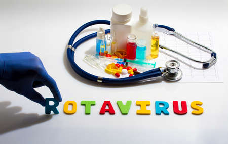 Diagnosis - Rotavirus. Medical concept with pills, injection, stethoscope, cardiogram and a syringe Foto de archivo