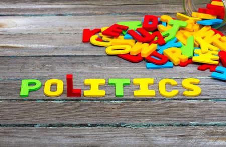 Politics text on wood background