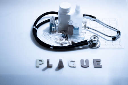 Diagnosis - Plague. Medical concept with pills, injection, stethoscope, cardiogram and a syringe