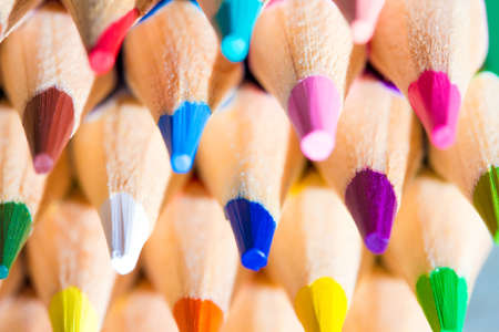 colored school: Colorful wooden pencils on grey background. Selective depth of field Stock Photo