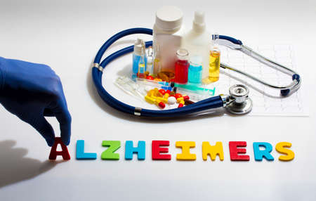 alzheimers: Diagnosis - Alzheimers. Medical concept with pills, injection, stethoscope, cardiogram and a syringe
