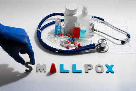 smallpox: Diagnosis - Smallpox. Medical concept with pills, injection, stethoscope, cardiogram and a syringe Stock Photo