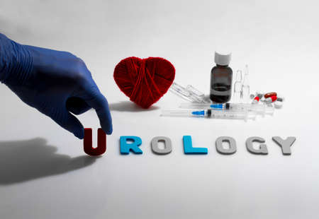 urology: Hand and urology word on the white background Stock Photo