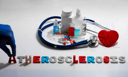 atherosclerosis: Diagnosis - Atherosclerosis. Medical concept with pills, injection, stethoscope, cardiogram and a syringe Stock Photo