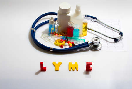 lyme: Diagnosis - Lyme. Medical concept with pills, injection, stethoscope, cardiogram and a syringe