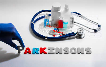 parkinson's: Diagnosis - Parkinsons. Medical concept with pills, injection, stethoscope, cardiogram and a syringe