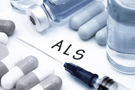 als: ALS - diagnosis written on a white piece of paper. Syringe and vaccine with drugs.
