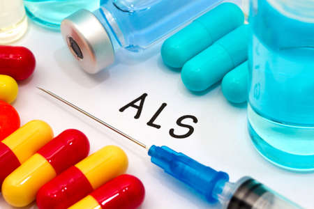 neurone: ALS - diagnosis written on a white piece of paper. Syringe and vaccine with drugs.