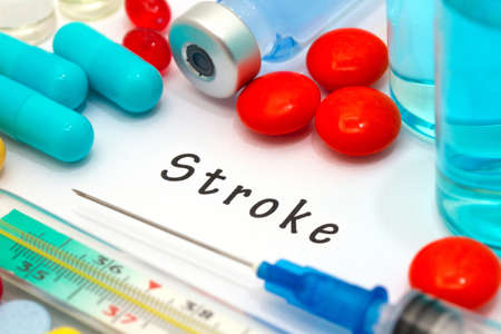 sudden death: Stroke - diagnosis written on a white piece of paper. Syringe and vaccine with drugs.