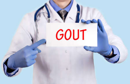 gout: Doctor keeps a card with the name of the diagnosis – gout. Selective focus. Medical concept.