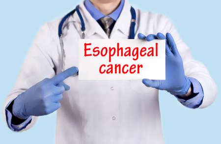 endoscopic: Doctor keeps a card with the name of the diagnosis � esophageal cancer. Selective focus. Medical concept.
