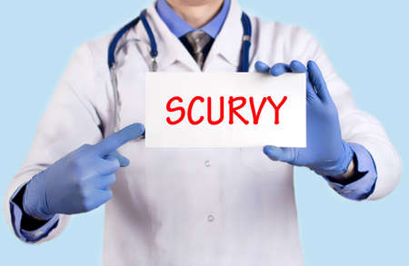 destructed: Doctor keeps a card with the name of the diagnosis – scurvy. Selective focus. Medical concept.