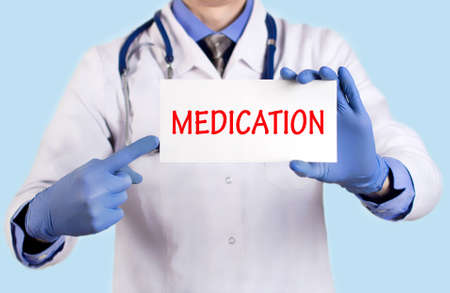 keeps: Doctor keeps a card with the name of the diagnosis � medication. Selective focus. Medical concept.