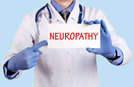 keeps: Doctor keeps a card with the name of the diagnosis � neuropathy. Selective focus. Medical concept.